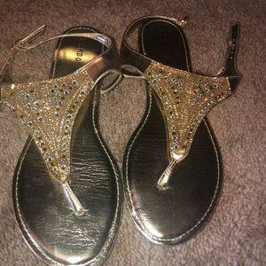 Never worn sandals. Cute for summer!